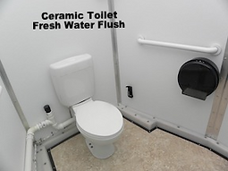 ceramic, toilet, fresh water, flush, grab bars, electricity, handicapped, stall, lavatory