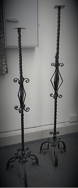A pair of wrought iron candlesticks (From St Mary's)