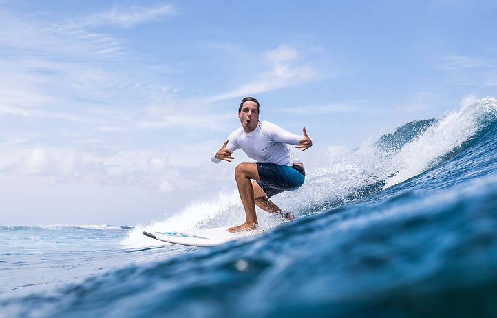 Surfing Thulusdhoo Maldives.jpg