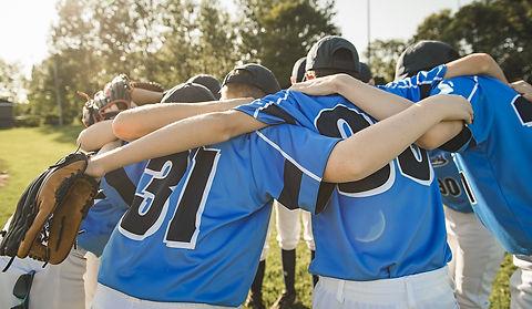 AdobeStock_289511219-Baseball-Team-Huddl
