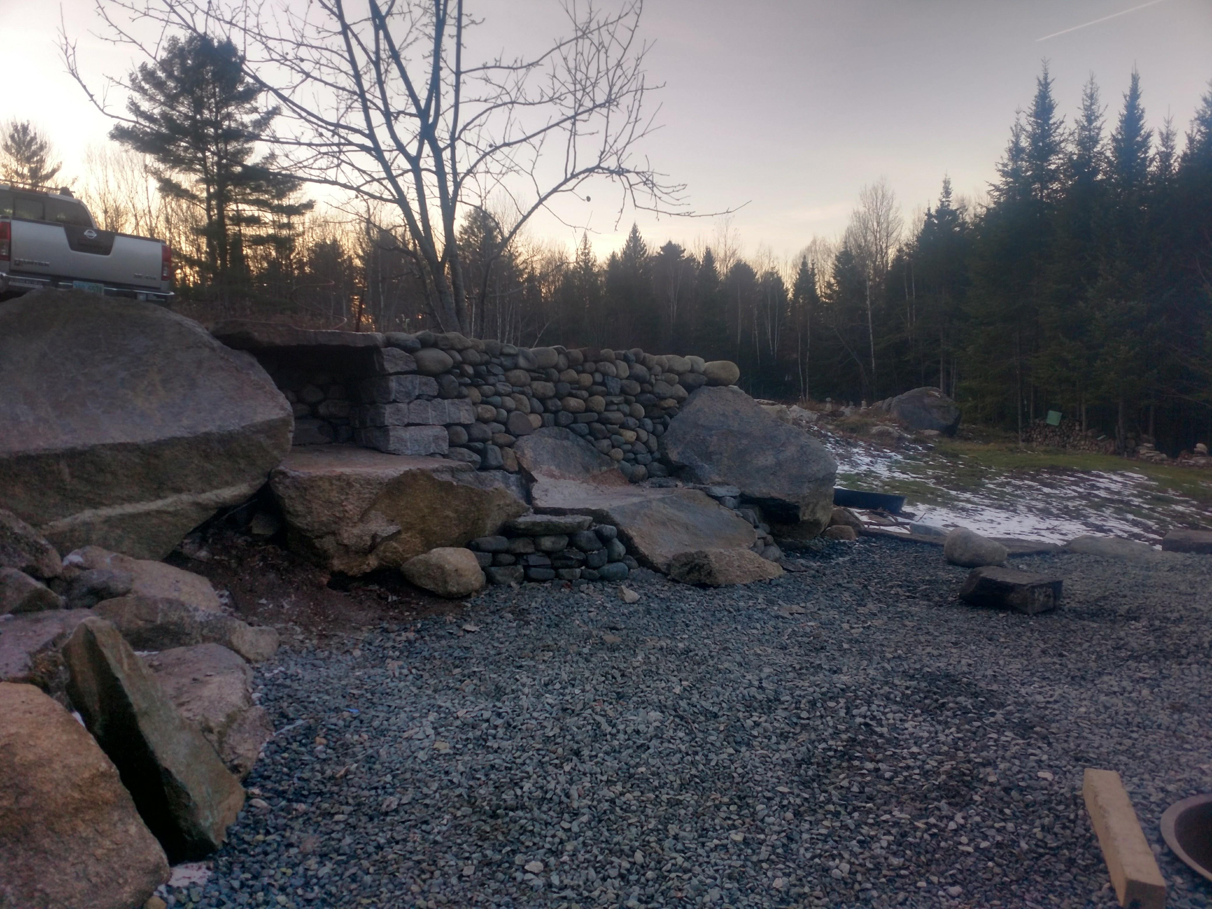 Carved boulder bench and nook