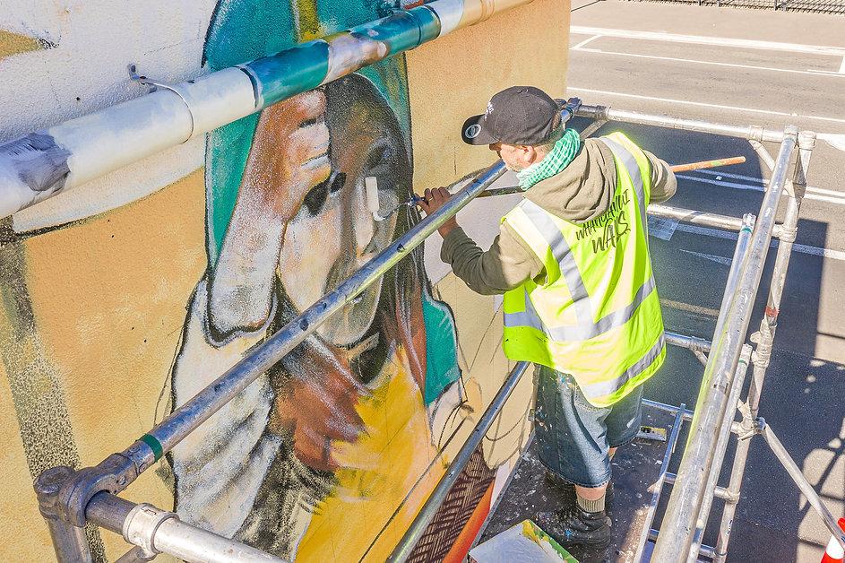 Dan Mills creating his street art