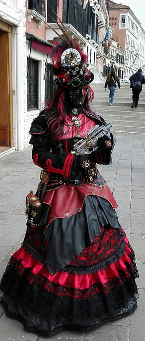 Attention getting, gun toting costume at Venice Carnival