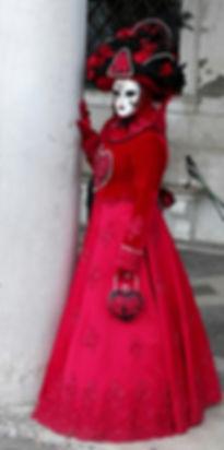 Striking vivid red costume at Venice Carnival.