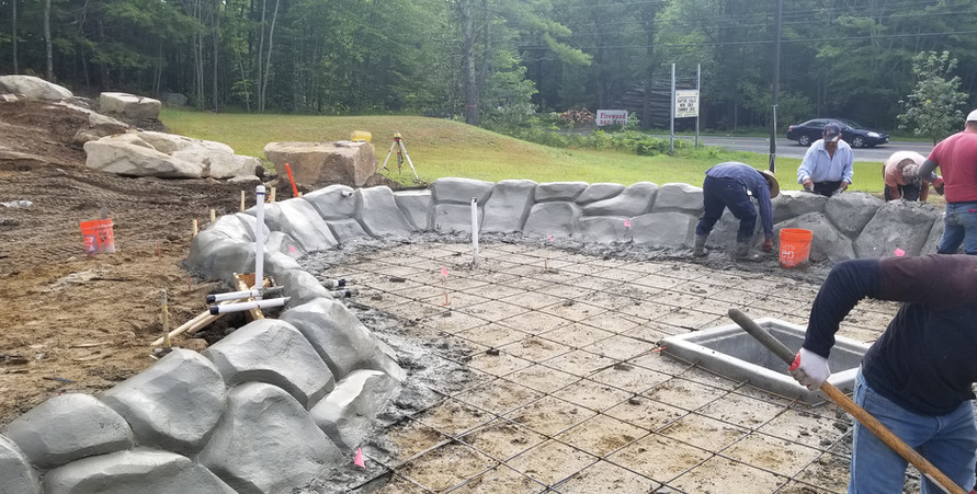Castle Golf company doing what they do best: building awesome mini golf features. Here they are forming the walls for the lower pond.