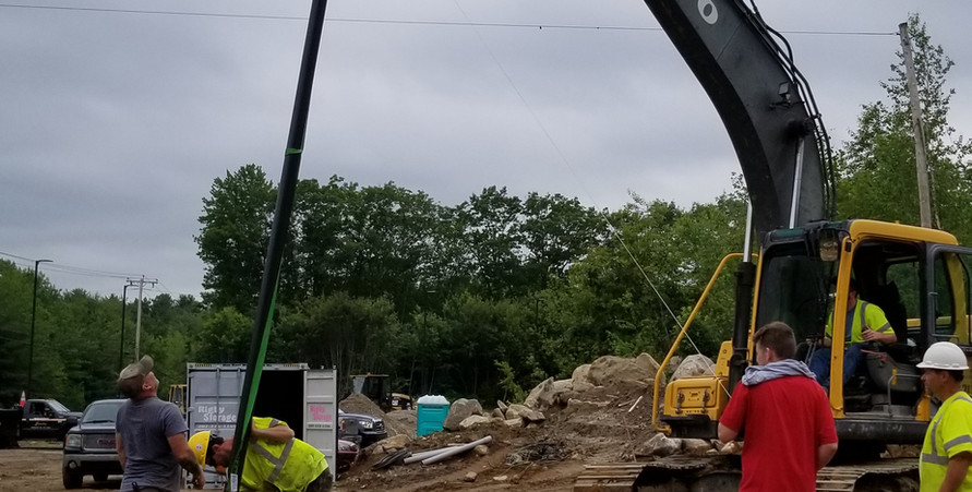 Colin Hunt with CGH Electric positioning the light poles. 6/27/2019