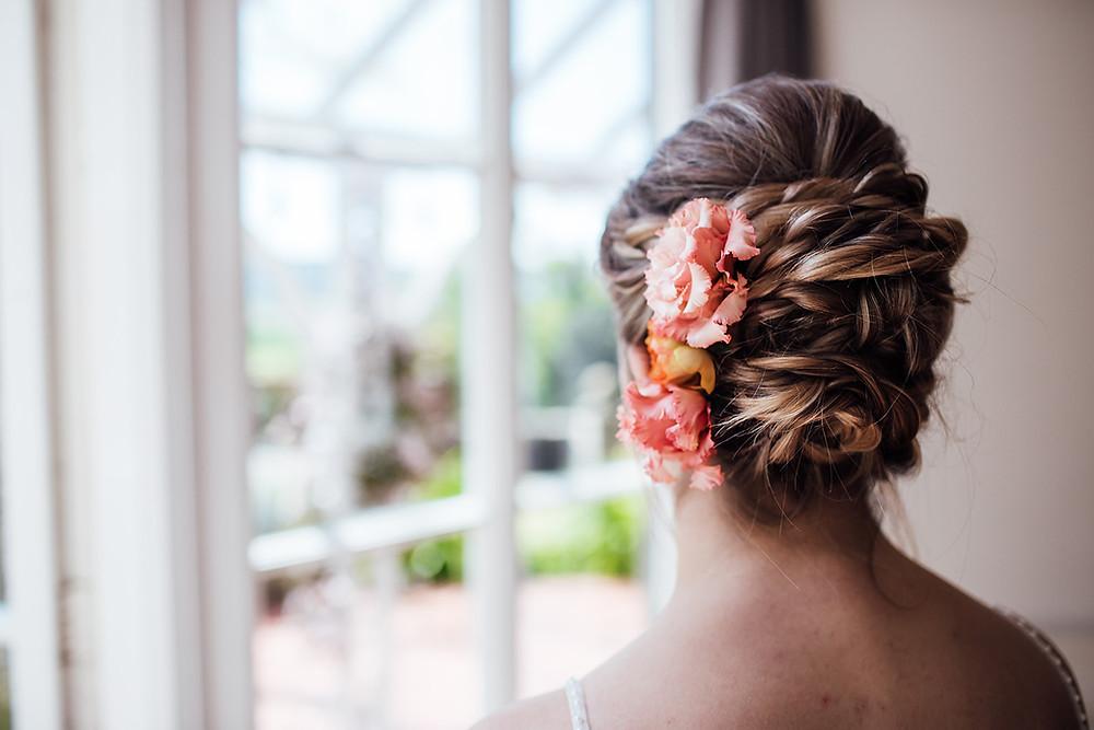 messy bun braid twist wedding hair fresh flowers