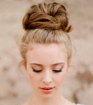 top knot wedding hairstyle high bun