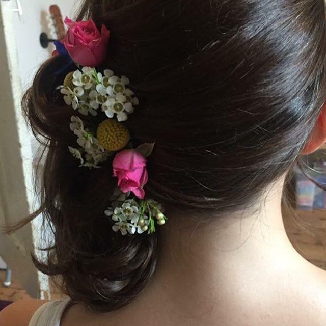bright flowers dark hair wedding updo