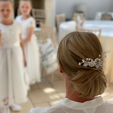 wedding updo how much is bridal hair cost?