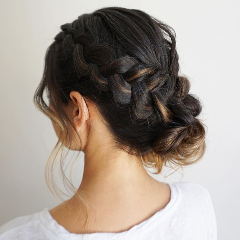 waterfall braid pulled into low bun wedding hair