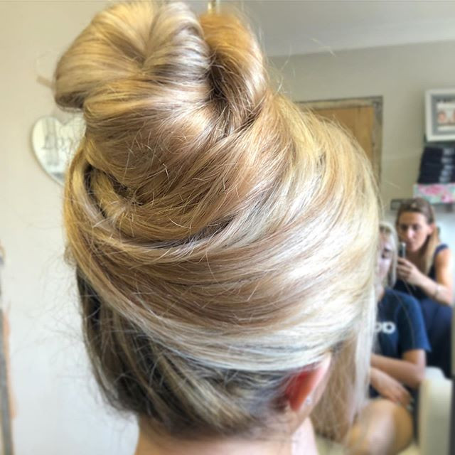 sweeping high bun on long naturally curly hair #bridalhair #bridesmaids #bridesmaidhair #hairupdos #promhair #promhairinspo #promhairstyles #weddinghairstylist #weddinghair #weddinghairstyles