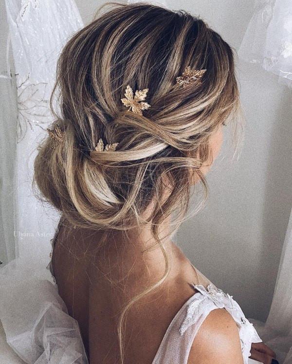 messy low bun romantic boho wedding hair