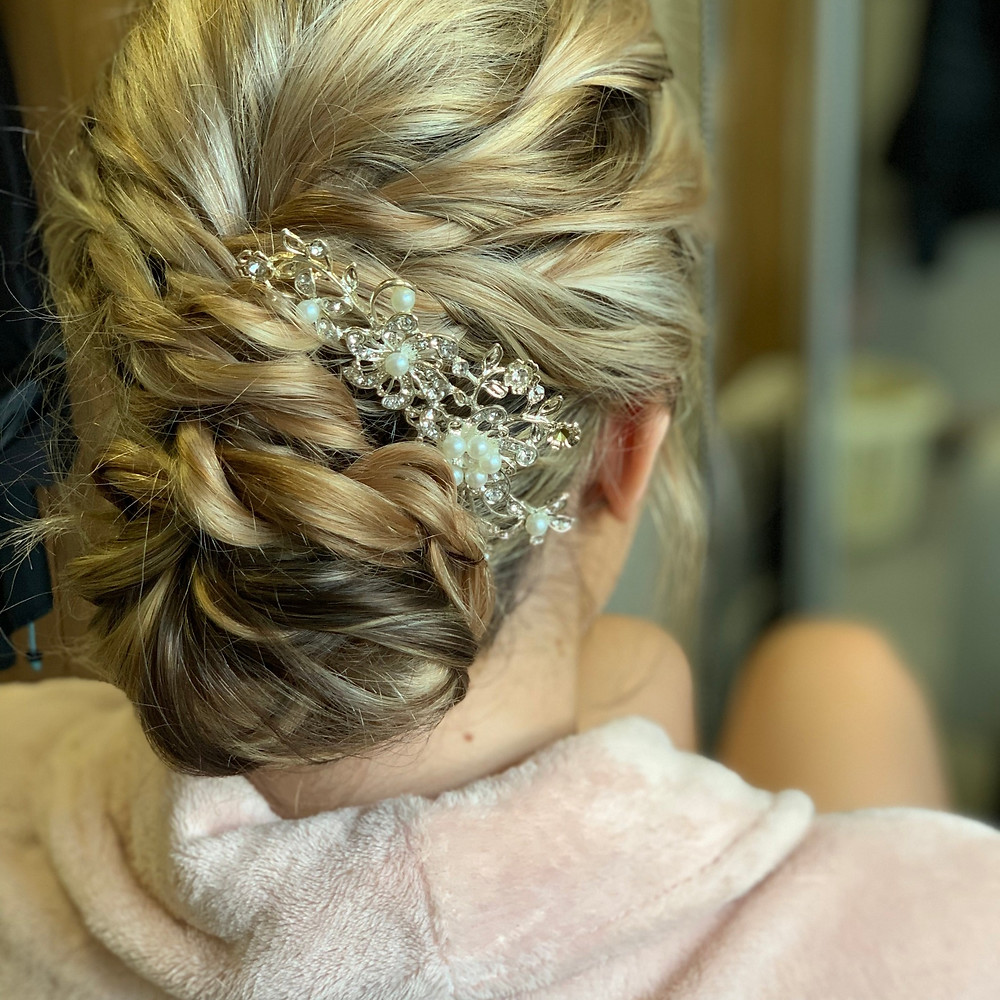 Twisted updo on long thick hair perfect with a side comb accessory. #twistedhairup #longhairupdo #bridalhair #weddinghair #bridesmaidhair
