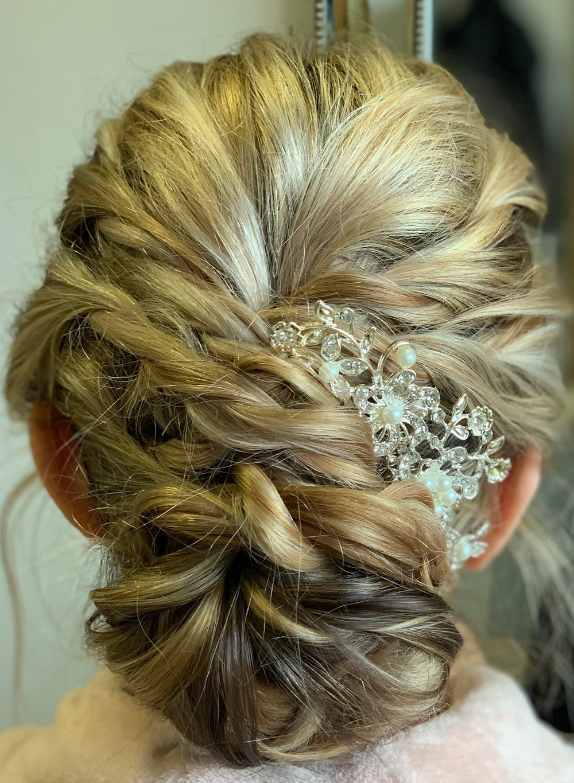 low curled bun braided bun crystal hair clip wedding accessory