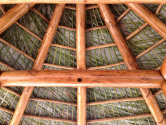 Cypress Log Structure with Palm Thatch
