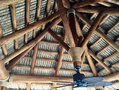 Cypress Log Structure with Natural Palm Thatch