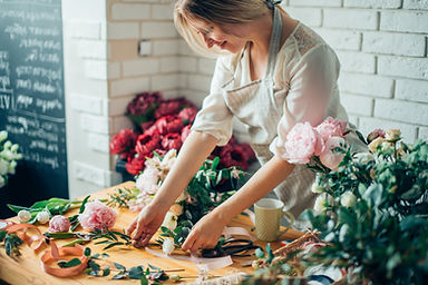 Small business. Male florist unfocused i