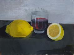 Citrons et verre de rouge