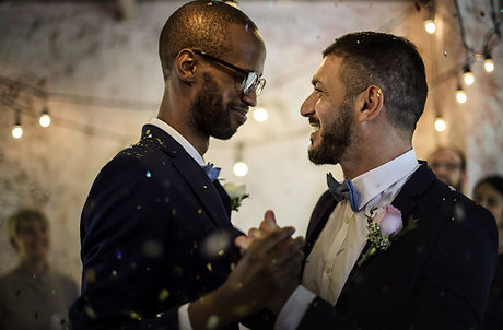 Closeup of Newlywed Gay Couple Dancing o