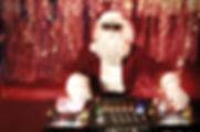DJ Santa Claus mixing up some Christmas cheer. Disco lights in the background._edited.jpg