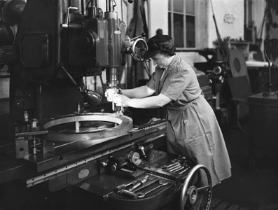 Woman worker operating machinery at Doncaster railway works, 1943