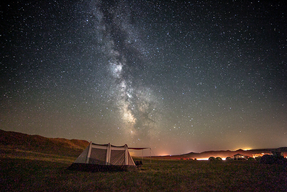 Camping under the stars: Milky Way rising over a tent