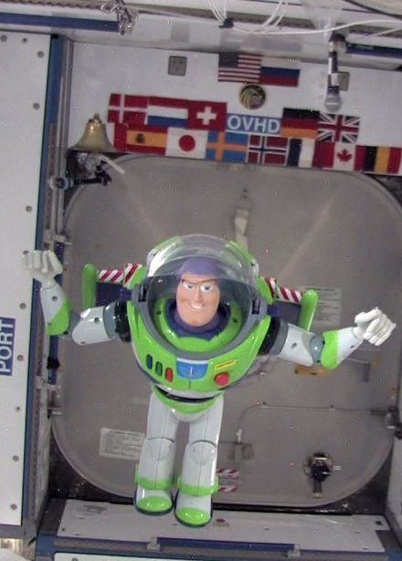 A Buzz Lightyear toy floating in zero gravity on board the International Space Station