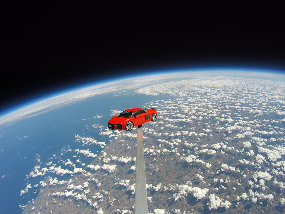 A model of an Audi R8 floating in space above the United Kingdom