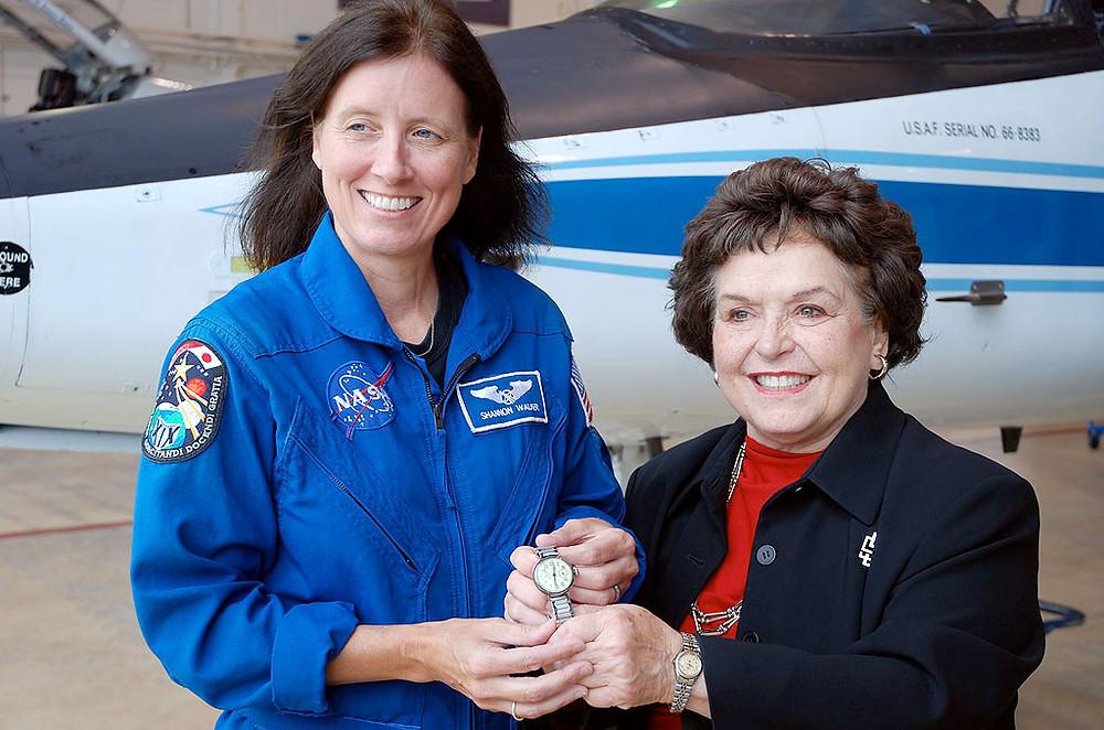 Ninety-Nines director Joan Kerwin presenting Amelia Earhart's watch to Astronaut Shannon Walker