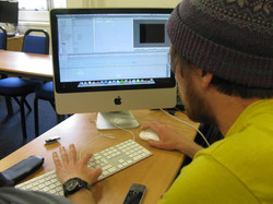 Young person editing own film