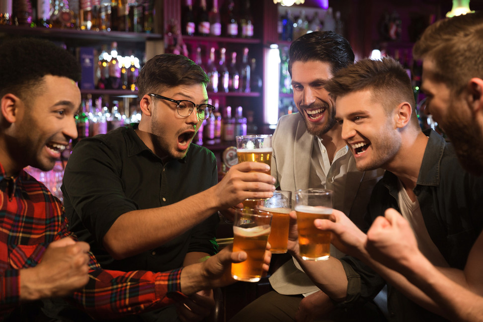 happy-male-friends-clinking-with-beer-mu