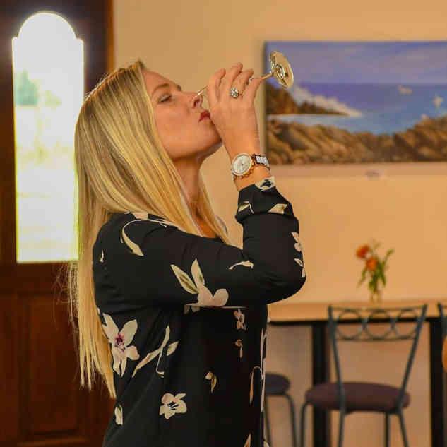 Beautiful lady tasting wine.jpeg