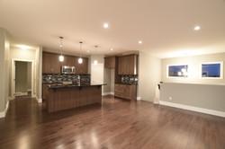 Brown Cabinets with Dark Backsplash