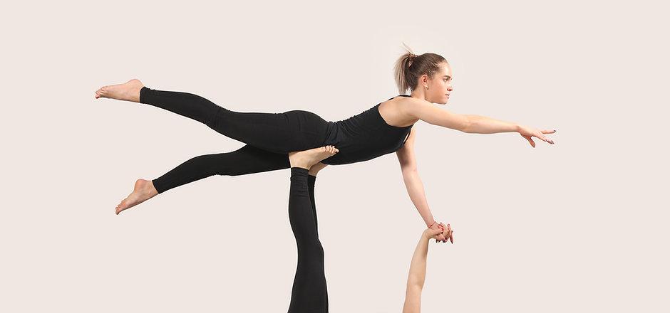 Women Practicing Acroyoga