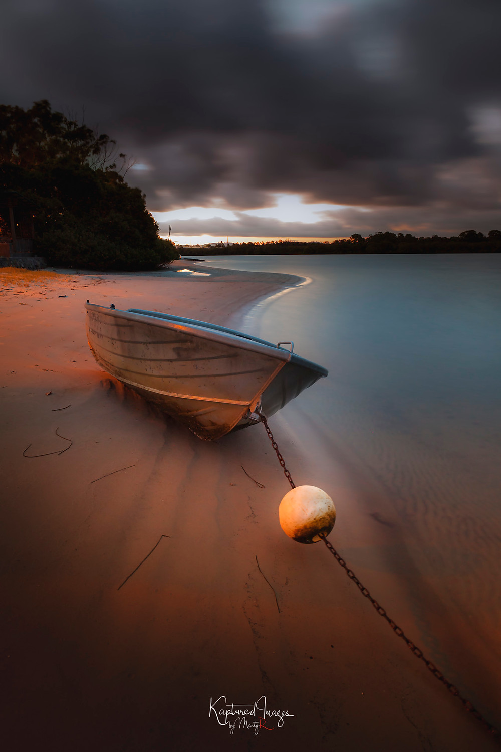 A small dinghy on the banks of the Maroochy River