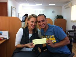 Netanel receiving a tuition check