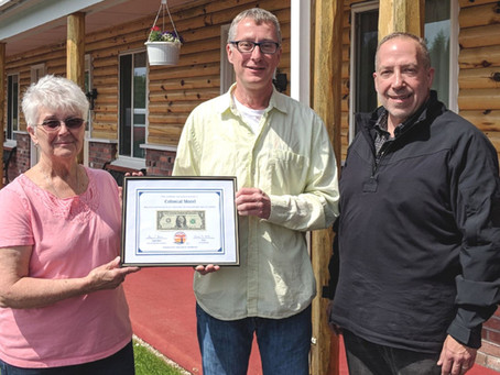 Colonial Motel Receives First Dollar