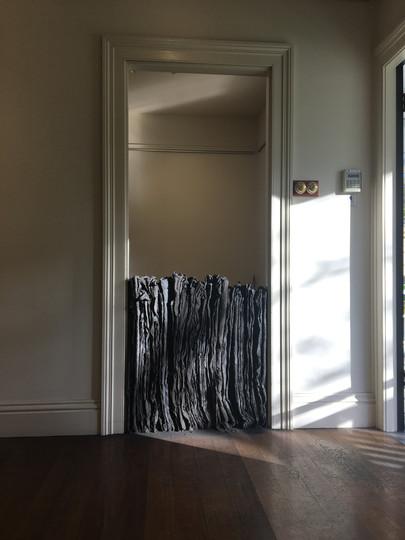 Schoolhouse Door Blockade, 2018, Fabric, cement, clay & iron oxide installation, 90x80x15cm