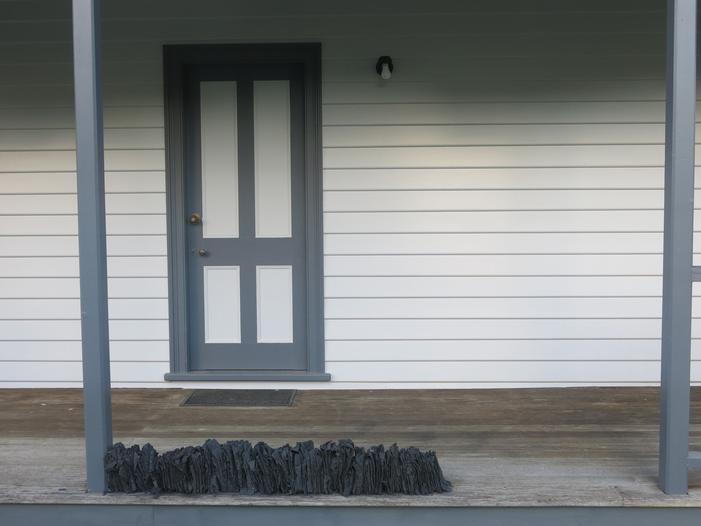 Half Post Verandah, 2018, Fabric, cement, clay & iron oxide installation, 120x25x15cm