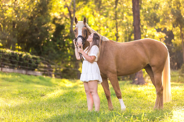 a girl and her horse in a photoshoot
