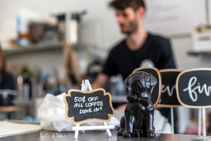 Little black pug cafe by Tails of Time Behind the Business