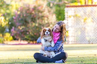 dog and owner posing at new farm park photoshoot