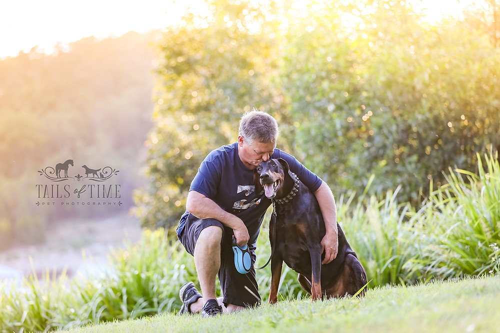 A man and his dog enjoy one another's company