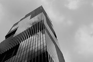 low-angle-shot-tall-high-rise-modern-business-building-with-clear-sky.jpg