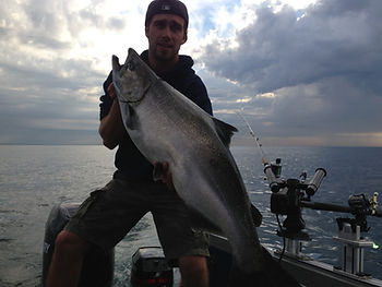 Chinook salmon fishing aboard Reel addiction sport fishing charter,Port credit,Toronto,Oakville,Niagara,Bluffers park,Bronte,Mississauga,
