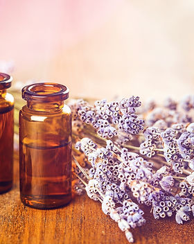 Pile of lavender flowers and a dropper bottle with lavender essence.jpg