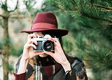 young-woman-holding-a-vintage-old-camera