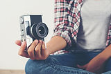 young-hipster-photographer-hand-holding-