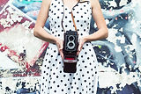 close-up-of-a-woman-in-polka-dress-holdi